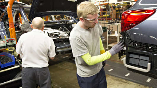 An employee inspects the body of a Subaru Outback, on the assembly line at the Subaru of Indiana Automotive, a manufacturing facility in Lafayette, Indiana.
