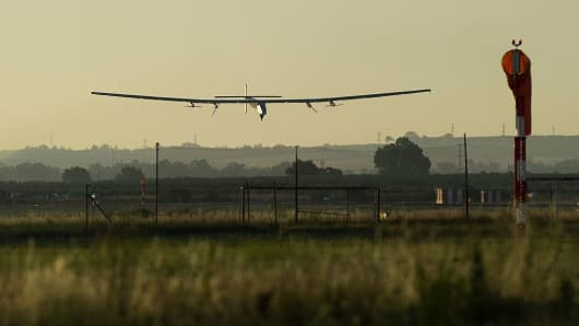 The Solar Impulse 2 aircraft lands at Sevilla airport on June 23, 2016, after a 70-hour journey from New York powered only by sunlight.