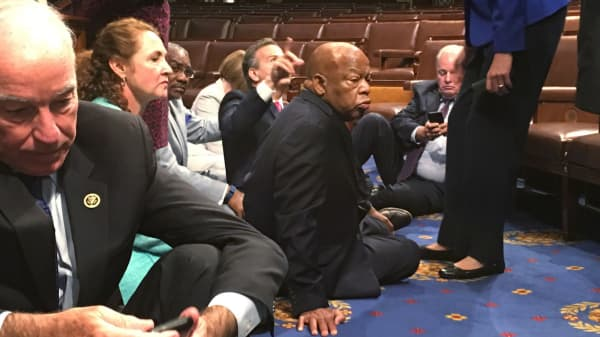 "A photo taken and tweeted from the floor of the House by U.S. House Rep. John Yarmuth shows Democratic members of the U.S. House of Representatives, including Rep. Joe Courtney (L) and Rep. John Lewis (C) staging a sit-in on the House floor ""to demand action on common sense gun legislation"" on Capitol Hill in Washington, June 22, 2016."