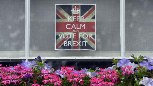 Vote leave posters are seen in a window in Chelsea.