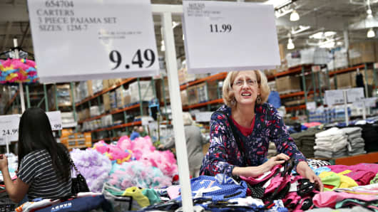Customers browse clothing on display at a Costco Wholesale store in Naperville, Illinois,