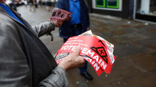 A campaigner hands out a 'Vote Remain' leaflet near Angel London Underground Station in London, U.K.