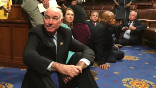 "A photo shot and tweeted from the floor by U.S. House Rep. John Yarmuth shows Democratic members of the U.S. House of Representatives, including Rep. Joe Courtney (C) staging a sit-in on the House floor ""to demand action on common sense gun legislation"" on Capitol Hill in Washington, June 22, 2016."