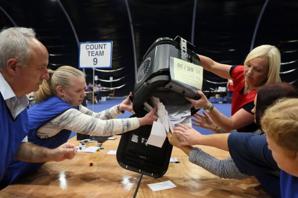 The first Ballot boxes are opened at the Titanic Exhibition centre, the Belfast count centre, on June 23, 2016 after polls closed in the referendum on whether the UK will remain or stay in the European Union (EU).