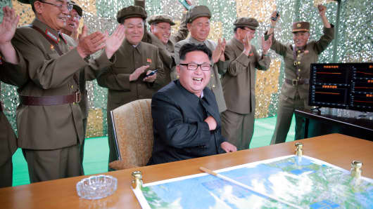 North Korean leader Kim Jong Un reacts during a test launch of ground-to-ground medium long-range ballistic rocket Hwasong-10 in this undated photo released by North Korea's Korean Central News Agency (KCNA) on June 23, 2016.