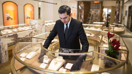 An employee adjusts a fine jewelry display inside a Bulgari SpA boutique.