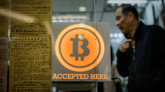A man walks out of a bitcoin retail shop in Hong Kong.