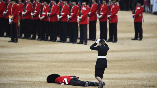 A Guardsman faints at Horseguards Parade for the annual Trooping the Colour ceremony in central London, Britain June 11, 2016