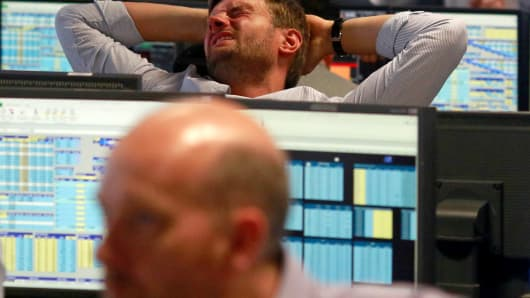 A trader from BGC, a global brokerage company in London's Canary Wharf financial centre reacts during trading June 24, 2016 after Britain voted to leave the European Union in the EU BREXIT referendum