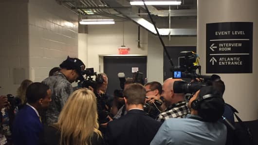 Brandon Ingram, second overall 2016 NBA draft pick, surrounded by reporters at the Barclays Center.