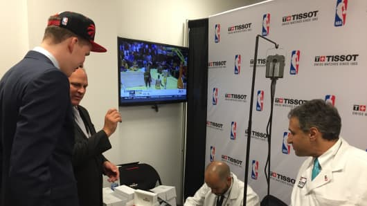 Jakob Poeltl, ninth overall 2016 NBA draft pick, waits for his Tissot watch.