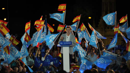 Spain's acting Prime Minister Mariano Rajoy of the caretaker government addresses his Popular Party supporters on June 24, 2016 in Madrid, Spain.