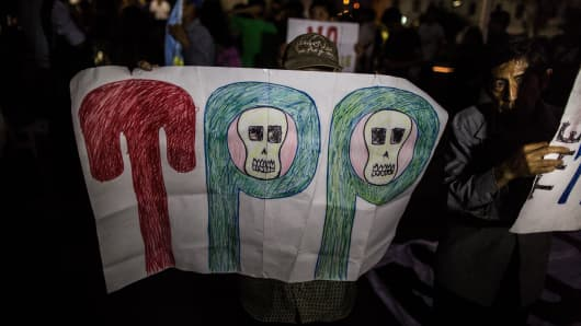 Demonstrators participate in a protest against the signing of the Trans-Pacific Partnership (TPP), in Lima, Peru, on February 25, 2016.