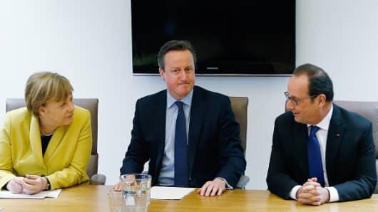 (L-R) Germany's Chancellor Angela Merkel, Britain's Prime Minister David Cameron and France's President Francois Hollande.