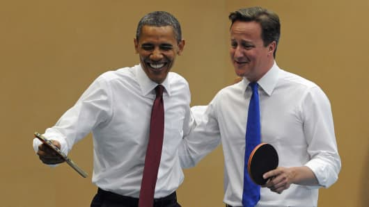 President Barack Obama (L) and Britain's Prime Minister David Cameron play table tennis at Globe Academy on May 24, 2011 in London, England.