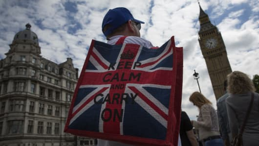 An American tourist stands near the Houses of Parliament the day after the majority of the British public voted to leave the European Union on June 25, 2016 in London, England.