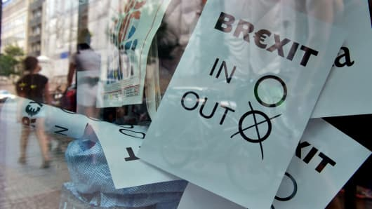 A poster featuring a Brexit vote ballot with 'out' tagged is on display at a book shop window.