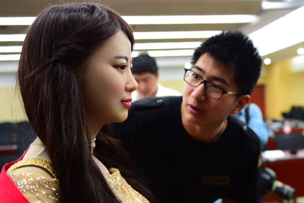 Jia Jia is examined by a journalist after her unveiling in April 2016 at the University of Science and Technology of China in Hefei.