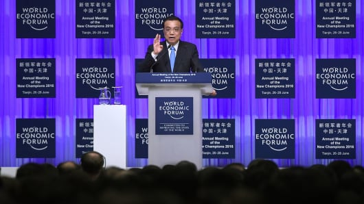 Chinese Premier Li Keqiang gives a speech during the World Economic Forum on June 27, 2016 in Tianjin, China.