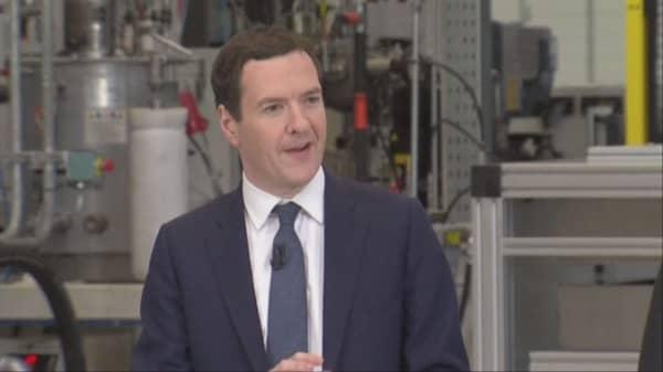 UK FinMin says Britain will raise taxes, cut spending