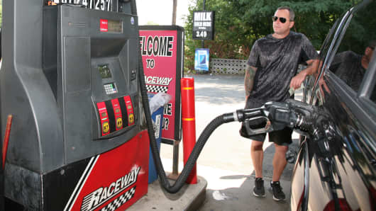 A motorist at a Raceway Petroleum station pumps gas in Woodbridge, New Jersey.