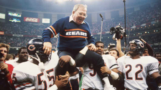 Defensive coordinator Buddy Ryan is held aloft by members of his defense including Otis Wilson #55, Richard Dent #95 and Dave Duerson #22, of the Chicago Bears, during Super Bowl XX on January 26, 1986 against the New England Patriots at the Superdome in New Orleans, Louisiana.