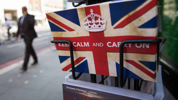 Postcards featuring the World War II British slogan 'Keep Calm and Carry On' are seen outside a newsagents in London, on 24 June, 2016.