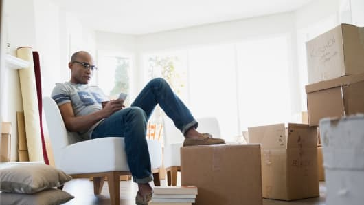 Millennial moving with boxes