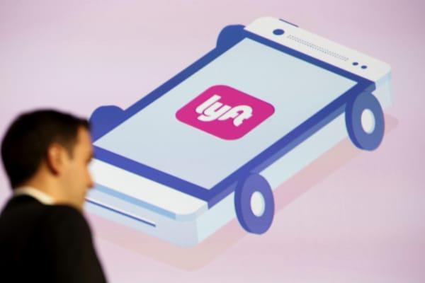 The Lyft Inc. logo is seen as John Zimmer, co-founder and president of Lyft Inc.