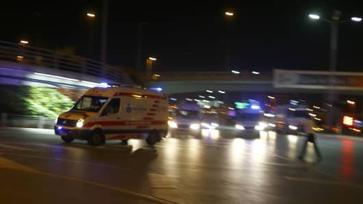 Ambulances arrive at Turkey's largest airport, Istanbul Ataturk, after a reported explosion.