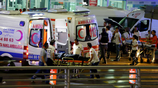 Paramedics push out a stretcher after a reported explosion.at Turkey's largest airport, Istanbul Ataturk