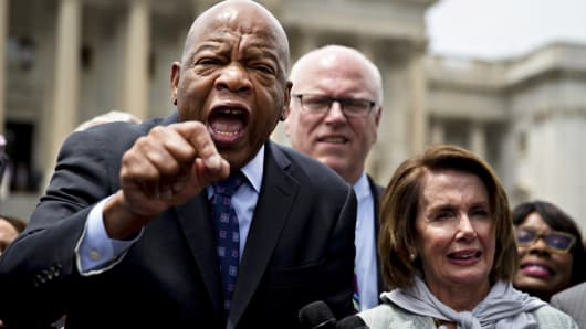 Representative John Lewis, a Democrat from Georgia, from left, speaks while standing next to Representative Joseph 'Joe' Crowley, a Democrat from New York, and House Minority Leader Nancy Pelosi, a Democrat from California, outside the U.S. Capitol in Washington, D.C., June 23, 2016.
