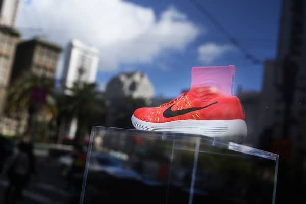 A Nike shoe is displayed in a window at a Nike store in San Francisco.