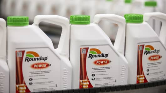 Bottles of Roundup weed killer move along the production line at the herbicide manufacturing facility operated by Monsanto.