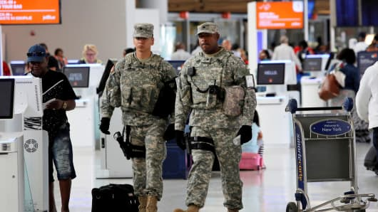 Members of the U.S. Army monitor the departures area at John F. Kennedy international Airport in New York, June 29, 2016.
