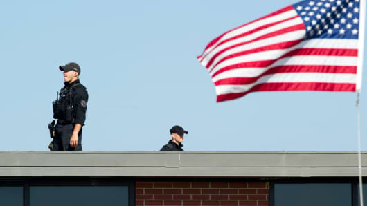 A file photo from yesterday showing the Secret Service Counter Sniper team awaiting the arrival of President Barack Obama at Andrews Air Force Base, Md.