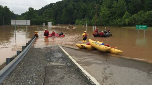 mergency crews take out boats on a flooded I-79 at the Clendenin Exit, after the state was pummeled by up to 10 inches of rain on Thursday, causing rivers and streams to overflow into neighboring communities, in Kanawha County, West Virginia