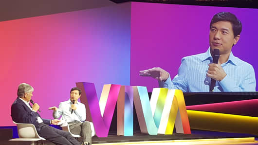 Maurice Levy, CEO of Publicis (L), interviews Robin Li, CEO of Baidu (R) at the Viva Technology conference in Paris on Friday, July 1.