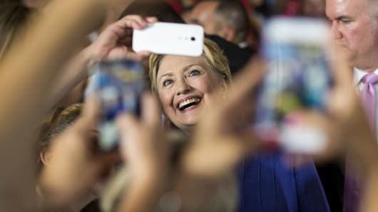 Hillary Clinton, former Secretary of State and presumptive Democratic presidential nominee, stands for a selfie photograph with attendees after speaking at a campaign event in Cincinnati, Ohio, U.S.