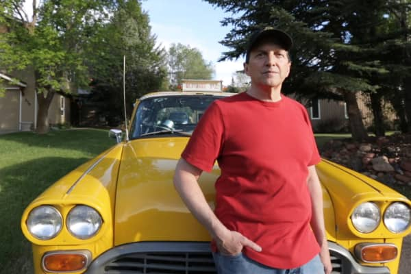Jon Barnes stands in front of the 1981 Checker cab he poured thousands of dollars into to create his Ultimate Taxi.