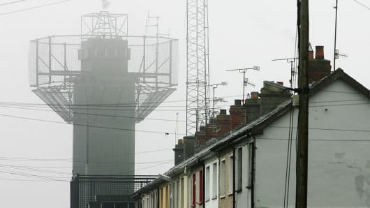 The highly fortified Crossmaglen police station is seen looming over the houses in the border village of Crossmaglen, Northern Ireland.