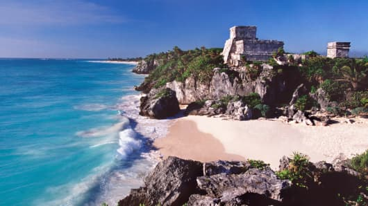 Mayan structure called El Castillo with Caribbean beach, at Tulum Archaeological Site, Mexico.
