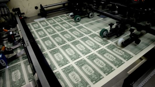 50 subject one dollar note sheets are run through an intaglio printing press before the face is printed at the U.S. Bureau of Engraving and Printing in Washington, D.C.