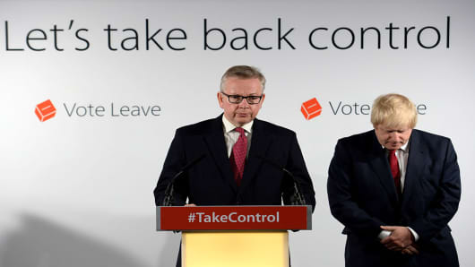 Michael Gove MP (L) speaks during a press conference following the results of the EU referendum at Westminster Tower on June 24, 2016 in London, England.