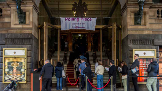 Voters line up to cast their vote at Melbourne town hall polling place on election day to determine all 226 members of the 45th Parliament of Australia on July 2, 2016.