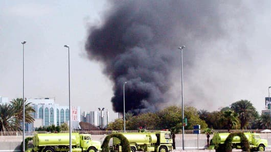 Smoke billowing from the US consulate in the Saudi Red Sea city of Jeddah 06 December 2004, Gunmen stormed the US consulate in Jeddah today, killing four guardsmen and seizing local staff in a hail of gunfire in the latest attack against foreigners in the oil-rich kingdom.