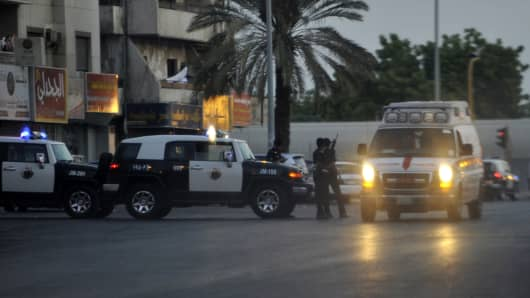 Saudi policemen stand guard at the site where a suicide bomber blew himself up in the early hours of July 4, 2016 near the American consulate in the Red Sea city of Jeddah.