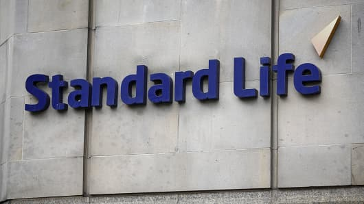 A Standard Life logo sits on a wall outside Standard Life House, the headquarters of Standard Life Plc, in Edinburgh, U.K., on Saturday, Aug. 9, 2014.