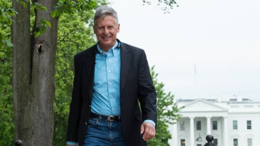Libertarian Party presidential candidate Gary Johnson walks in Lafayette Park across from the White House during an interview with AFP in Washington, DC, on May 9, 2016.