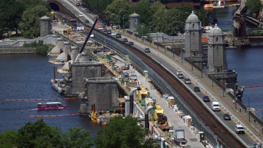Repairs on the Longfellow Bridge continue, including the removal of a couple of salt and pepper shaker-like towers.